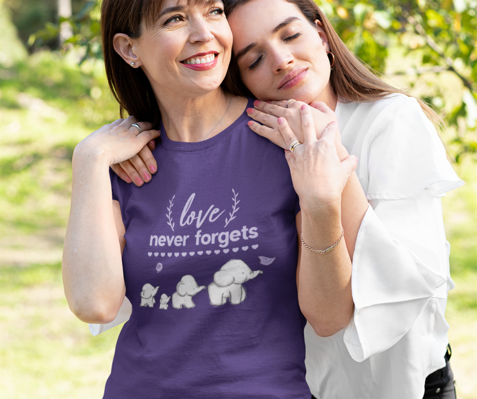 Mother wearing purple Alzheimer's and Brain Awareness T-Shirt, being hugged by daughter.