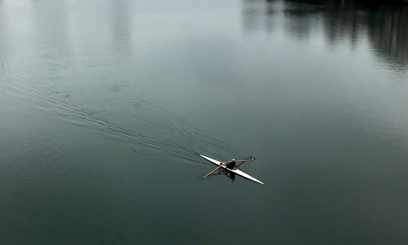A lone sculler on Lady Bird Lake.