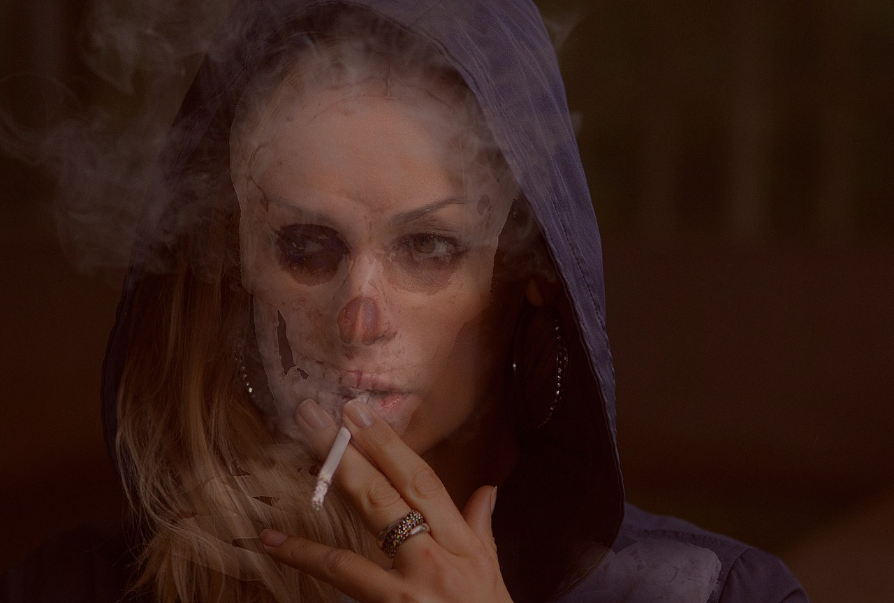 Woman smoking with skull like appearance.