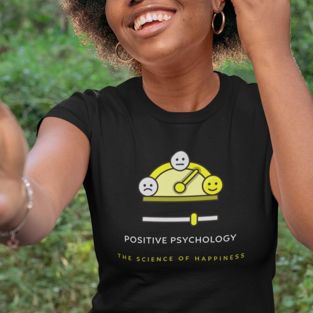 Smiling woman wearing positive psychology t-shirt.