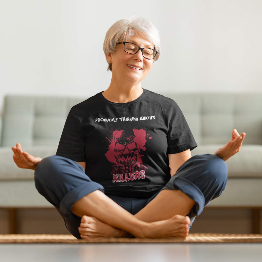 Mature woman meditating wearing a Probably Thinking About Serial Killers T-Shirt.